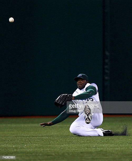 Centerfielder Elijah Dukes of the Tampa Bay Devil Rays tries to snag an RBI single by Nick Swisher of the Oakland Athletics at Tropicana Field on May...