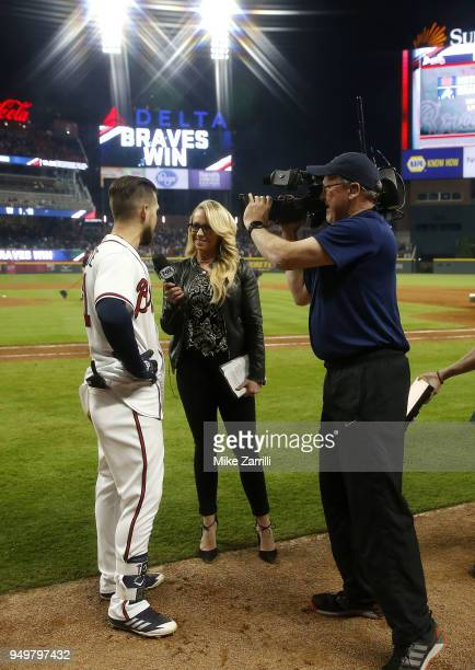 Centerfielder Ender Inciarte of the Atlanta Braves is interviewed by Fox Sports South field reporter Kelsey Wingert after Inciarte's game winning...