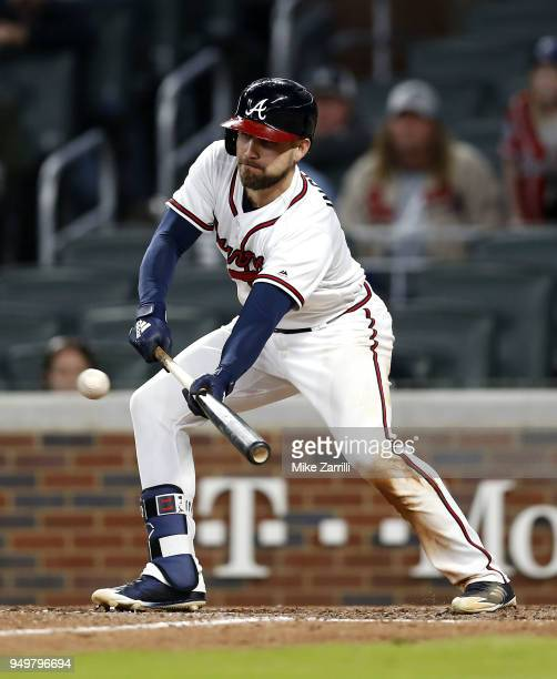 Centerfielder Ender Inciarte of the Atlanta Braves lays down a game winning squeeze play bunt in the ninth inning during the game against the New...