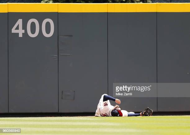 Centerfielder Ender Inciarte of the Atlanta Braves lies in the outfield after running into the center field wall in the fourth inning during the game...