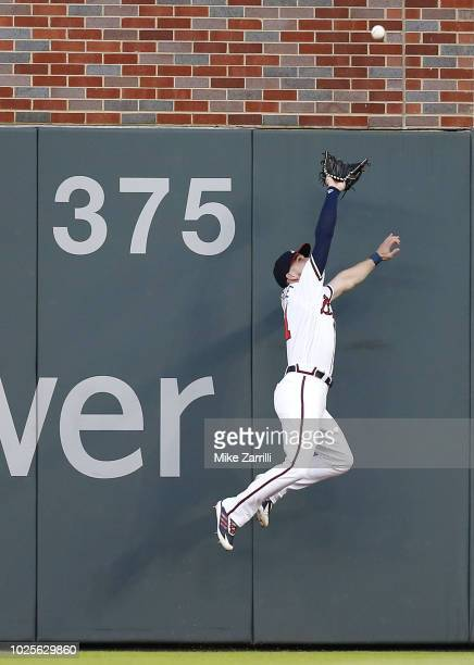 Centerfielder Ender Inciarte of the Atlanta Braves makes a leaping catch on a fly ball during the game against the Pittsburgh Pirates at SunTrust...