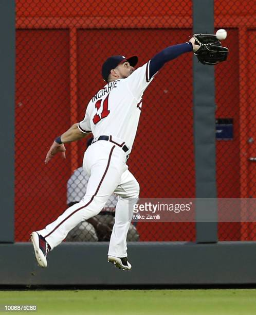 Centerfielder Ender Inciarte of the Atlanta Braves makes a running catch on a fly ball in the fifth inning during the game against the Los Angeles...