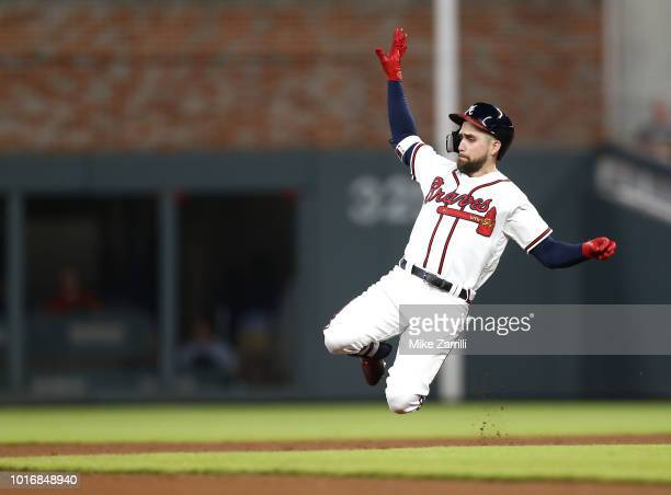 Centerfielder Ender Inciarte of the Atlanta Braves slides into second base for a double in the seventh inning during the game against the Miami...