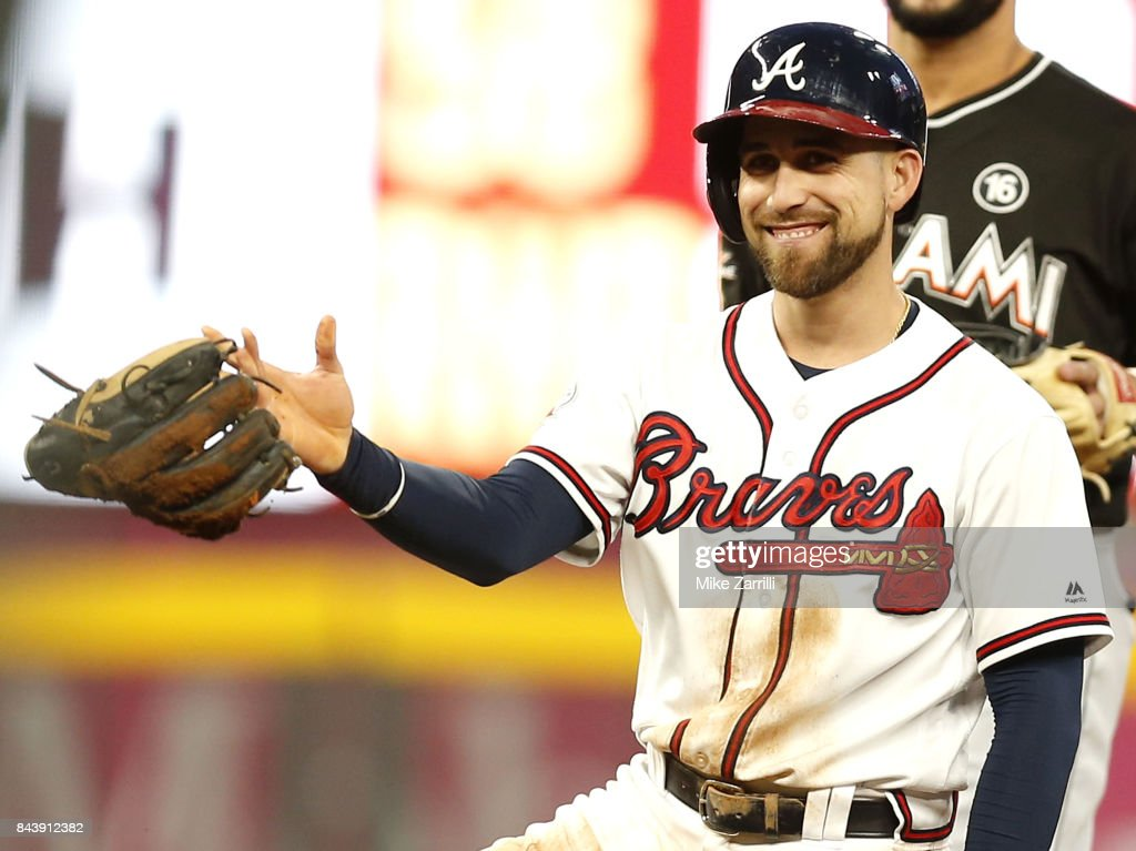Centerfielder Ender Inciarte #11 of the Atlanta Braves smiles and gives back the glove of second baseman Dee Gordon #9 of the Miami Marlins (not pictured) after Inciarte stole second and slid over Gordon's glove in the first inning during the game at SunTrust Park on September 7, 2017 in Atlanta, Georgia.