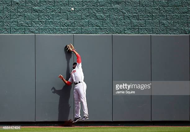 Centerfielder Jackie Bradley Jr #25 of the Boston Red Sox reaches for a flay ball hit by Eric Hosmer of the Kansas City Royals that sails over the...
