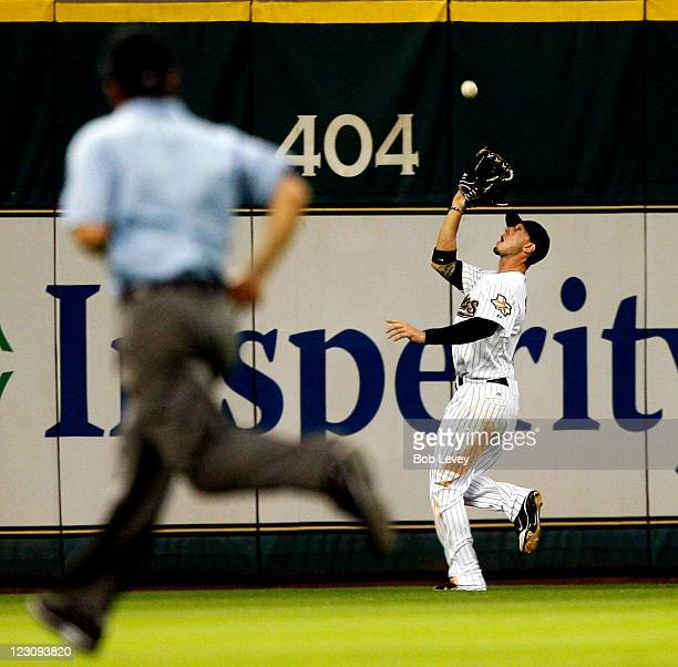 Centerfielder Jordan Schafer of the Houston Astros tracks down a deep fly ball against the Pittsburgh Pirates at Minute Maid Park on August 30 2011...