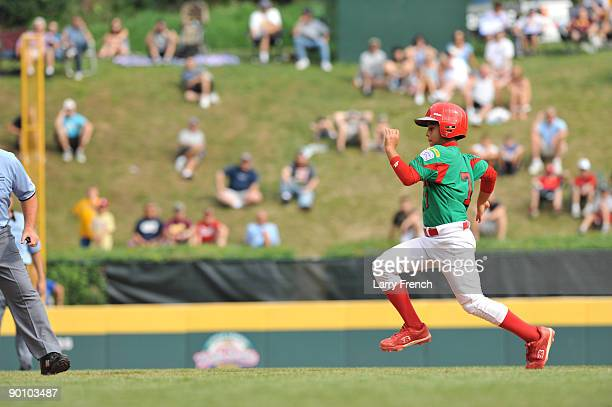 Centerfielder Luis Trevino of Reynosa Mexico takes third base against Chiba City Japan in the international semifinal at Lamade Stadium on August 26...