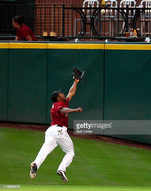 Centerfielder Michael Bourn of the Houston Astros can't trach down this deep fly ball from Justin Upton of the Arizona Diamondbacks in the sixth...
