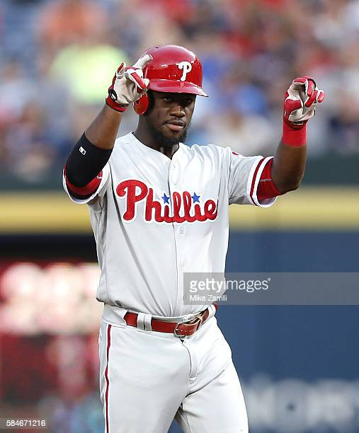 Centerfielder Odubel Herrera of the Philadelphia Phillies celebrates after hitting an RBI double in the third inning during the game against the...