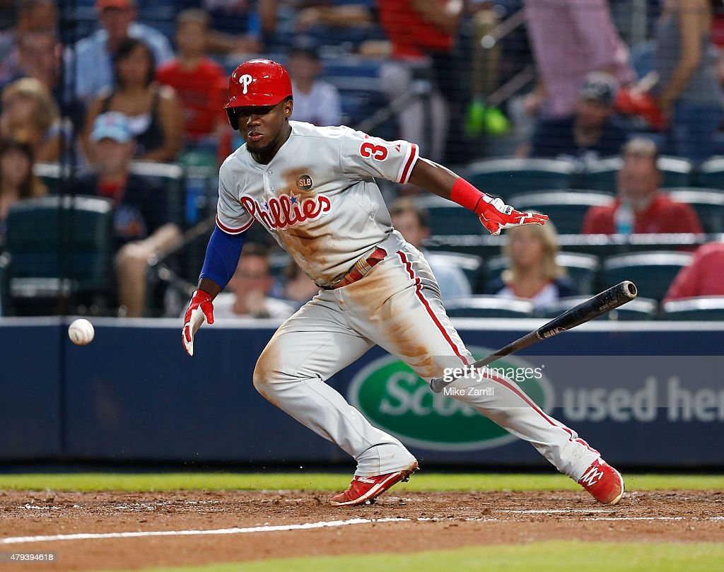 Centerfielder Odubel Herrera #37 of the Philadelphia Phillies drops a sacrifice bunt down in the fifth inning during the game against the Atlanta Braves at Turner Field on July 3, 2015 in Atlanta, Georgia.