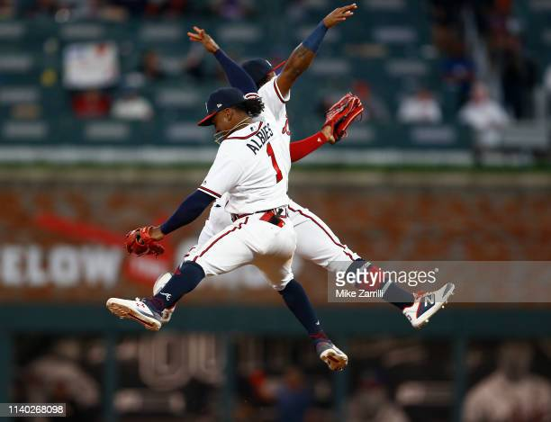 Centerfielder Ronald Acuna, Jr. #13 and second baseman Ozzie Albies of the Atlanta Braves jump and high five after the game against the Chicago Cubs...