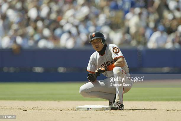 Centerfielder Tsuyoshi Shinjo of the San Francisco Giants looks on while resting at second base against the Los Angeles Dodgers during the MLB game...