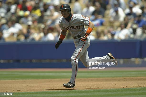 Centerfielder Tsuyoshi Shinjo of the San Francisco Giants runs to second base against the Los Angeles Dodgers during the MLB game on July 20 2002 at...