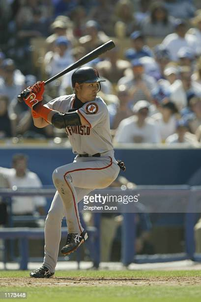 Centerfielder Tsuyoshi Shinjo of the San Francisco Giants starts his swing motion against the Los Angeles Dodgers during the MLB game on July 20 2002...