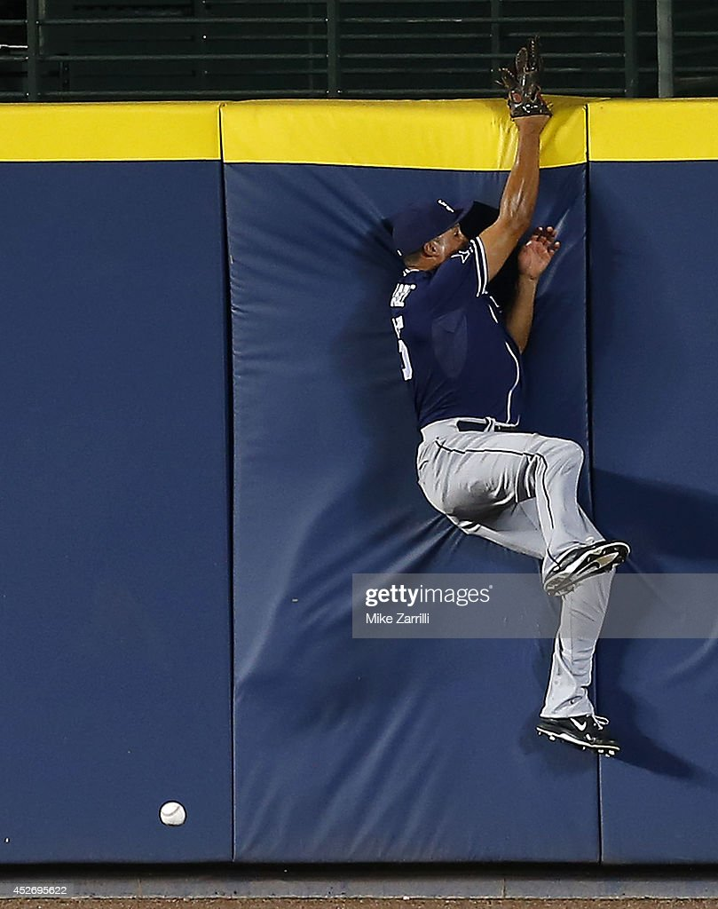 Centerfielder Will Venable #25 of the San Diego Padres crashes into the outfield wall trying to pursue a ball hit by first baseman Freddie Freeman #5 of the Atlanta Braves (not pictured) in the sixth inning of the game against the Atlanta Braves at Turner Field on July 25, 2014 in Atlanta, Georgia.