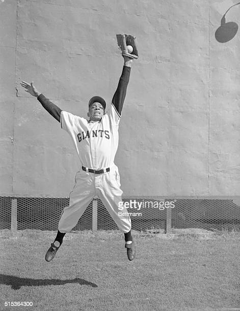 Centerfielder Willie Mays, of the New York Giants baseball team is shown here making an outstanding catch.