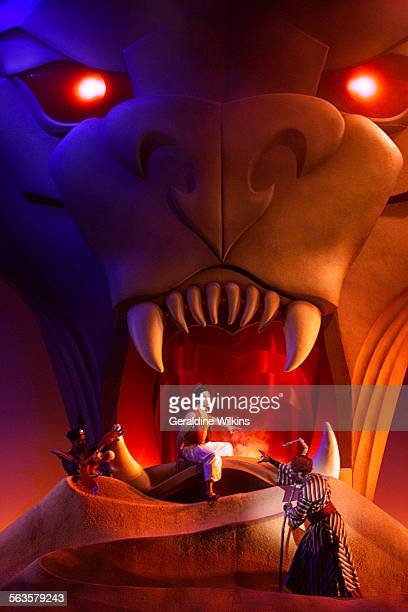 Centerleft and right–In the scene 'Cave of Wonders' Aladdin portrayed by Miles Wesley is surrounded by Jafar portrayed by Lance Roberts and Iago...