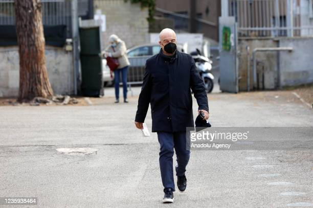 Center-right candidate Enrico Michetti arrives at a polling station to vote for the runoff elections for mayor in Rome, Italy, on October 17, 2021....