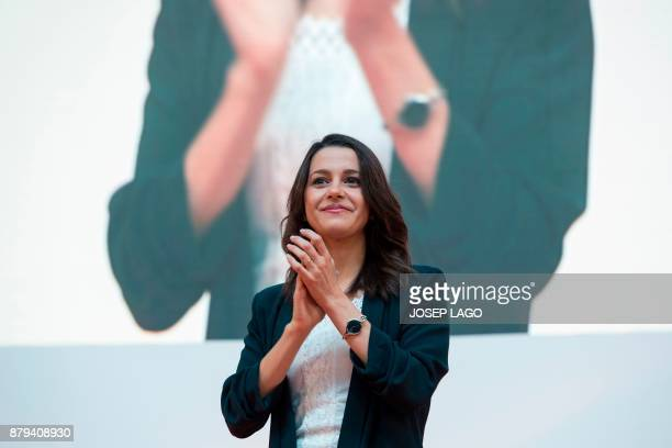 Centerright party Ciudadanos candidate for the upcoming regional election in Catalonia Ines Arrimadas applauds during a meeting to present the...