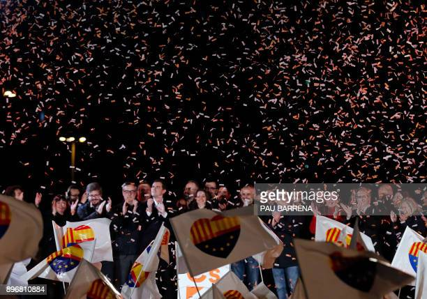 TOPSHOT Centerright party Ciudadanos candidate Ines Arrimadas and the rest of candidates and party members celebrate their polls results in the...
