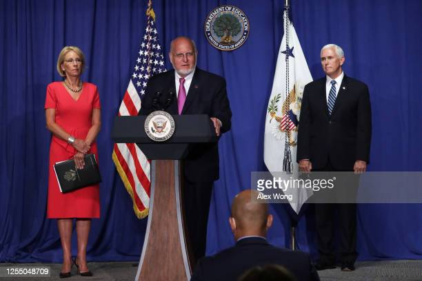 Centers for Disease Control and Prevention Director Robert Redfield speaks as U.S. Secretary of Education Betsy DeVos and Vice President Mike Pence...