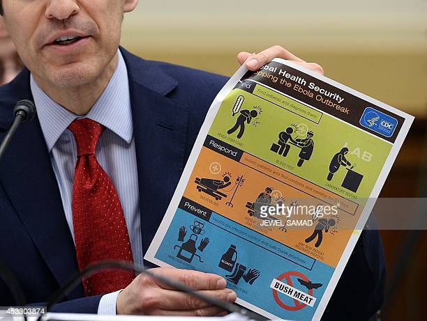 US Centers for Disease Control and Prevention Director Tom Frieden shows an awareness poster as he testifies before Africa Global Health Global Human...