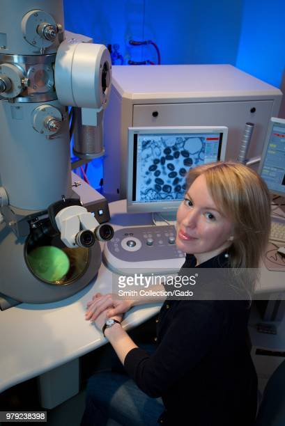Centers for Disease Control and Prevention intern Maureen Metcalfe using transmission electron microscopes 2011 Image courtesy Centers for Disease...
