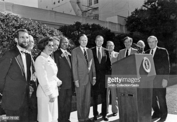 Centers for Disease Control officials in visit to the White House CDC Director at that time William L Roper former Director James O 1991 Mason...