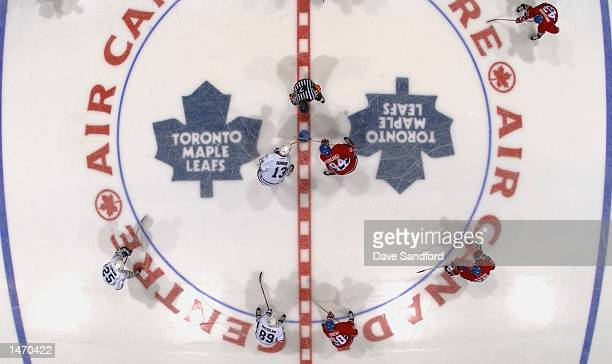 Centers Mats Sundin of the Toronto Maple Leafs and Yanic Perreault of the Montreal Canadiens face off during the NHL game on October 2, 2002 at the...
