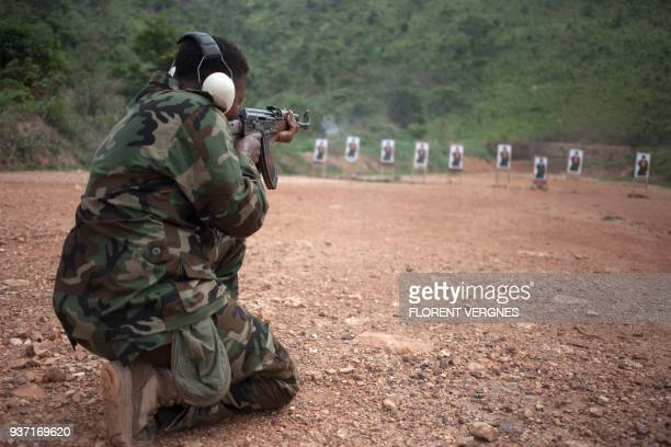 A Central African Armed Forces soldier trains with an assault rifle during a training session at Camp Kassai in Bangui on March 14 2018 At this...