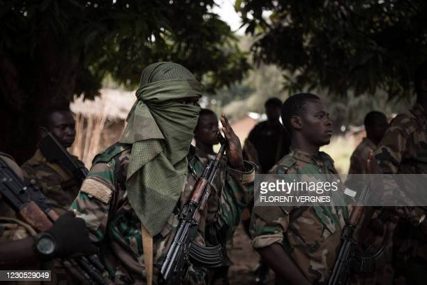 Central African Armed Forces soldiers stand on attention on the road between Boali and Bangui on January 10, 2021.