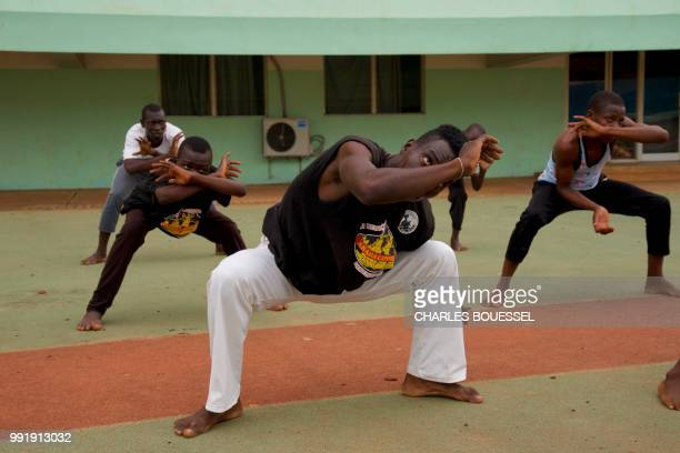 Central African Capoeiristas train at the stadium in Bangui on July 1 2018 Every Sunday young people from all walks of life gather at Bangui's...
