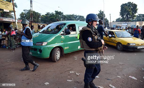 Central African gendarmes patrol with French gendarmes of the Sangaris operation in a street of Bangui, on April 29, 2014. Two civilians were killed...