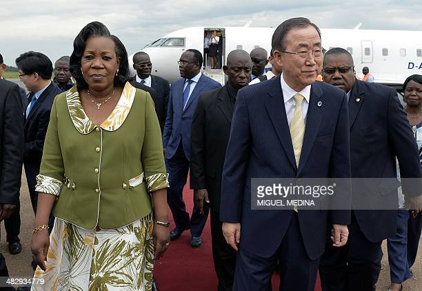 Central African Interim president Catherine Samba-Panza walks with UN Secretary-General Ban Ki-Moon upon his arrival at Bangui's airport on April 5,...