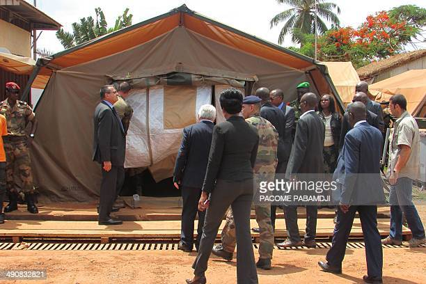 Central African officials and French soldiers of the Sangaris operation arrive to attend a ceremony for late French journalist Camille Lepage on May...