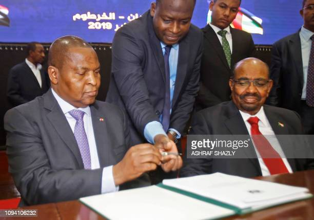 Central African president FaustinArchange Touadera inks a peace deal next to Sudanese President Omar alBashir in Khartoum on February 05 2019 The...