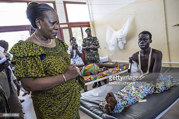 Central African Republic President Catherine Samba Panza visits the victims of the latest wave of violence at the General Hospital in Bangui on June...