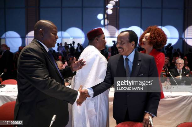 Central African Republic president FaustinArchange Touadera Niger president Mahamadou Issoufou Cameroun president Paul Biya and his wife Chantal Biya...