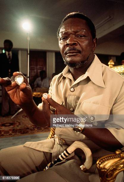 Central African Republic President Jean Bedel Bokassa holding diamonds in 1977 Bokassa came to power through a military coup and later declared...
