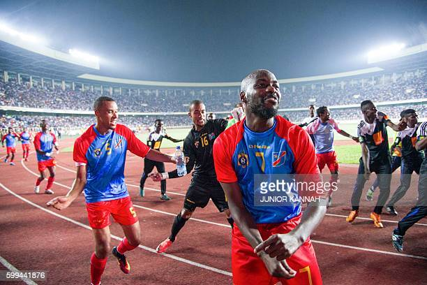 Central African Republic 's and Democratic Republic of the Congo's Youssouf Mulumbu jubilates with teammates at the end of the 2017 African Cup of...