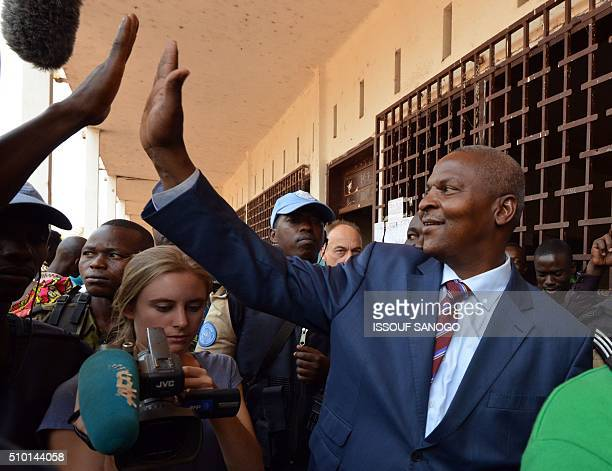 Central African Republic second round presidential candidate Faustin Archange Touadera leaves a polling station in Bangui on February 14 after...
