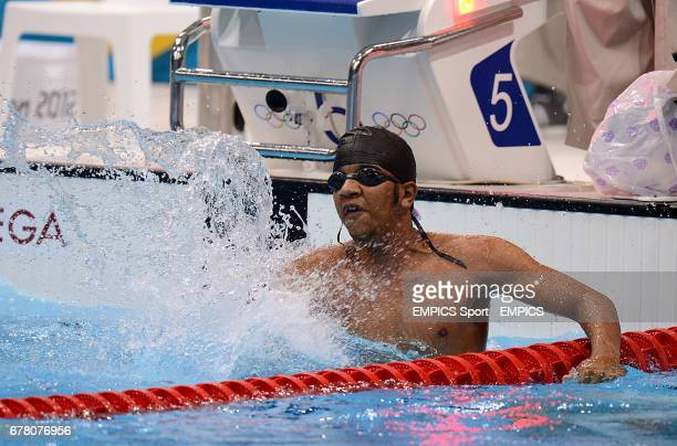 Central African Republic's Christian Nassif celebrates winning in the Men's 50m Freestyle Heats