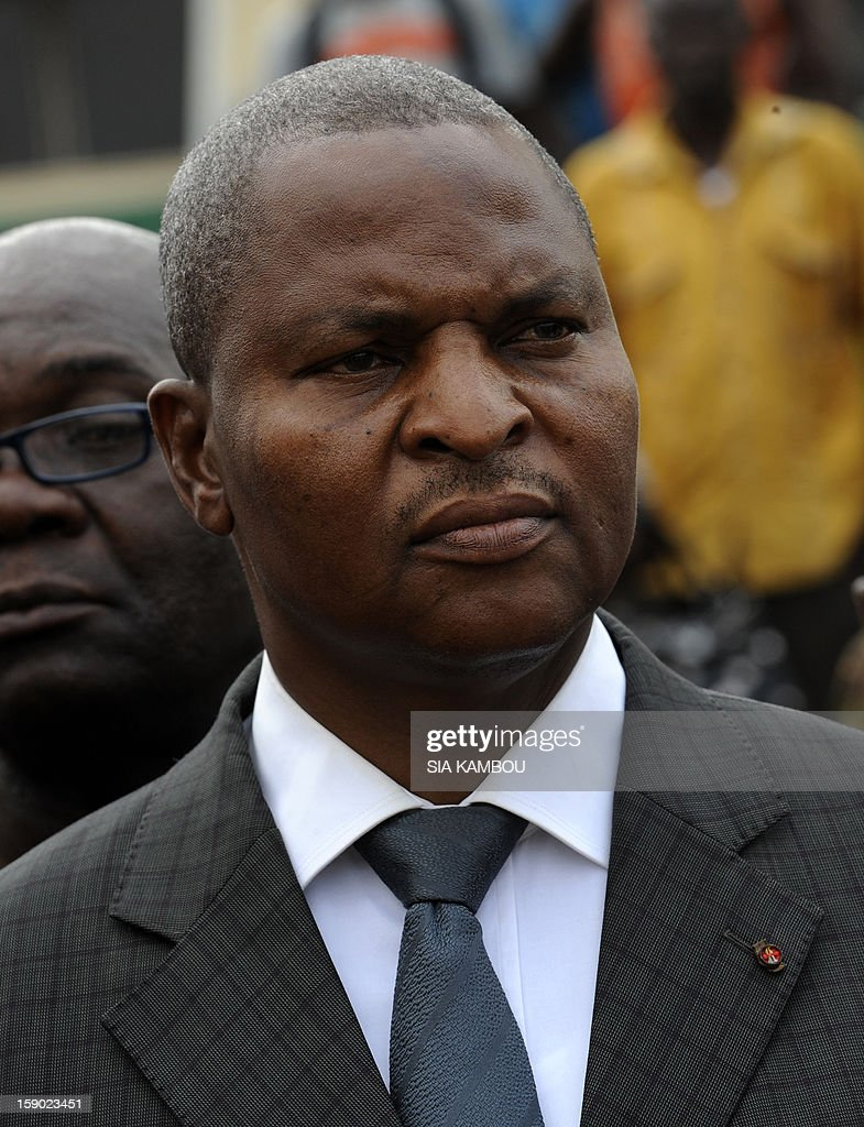 Central African Republic's Prime Minister Faustin Archange Touadera looks on as he takes part in a march for peace in Bangui, on January 5, 2013. Central African Republic rebels captured two more towns overnight, just days before talks were due to open on the crisis in the impoverished country, an official said on January 5. 'The rebels took two towns near Bambari,' a town already under the control of the Seleka rebel coalition, Territorial Administration Minister Josue Binoua told AFP.