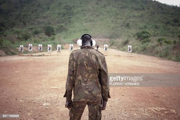 A Central African soldier trains with the AK47 assault weapon on the European launch pad at Camp Kassai in Bangui on March 14 2018 At this location...