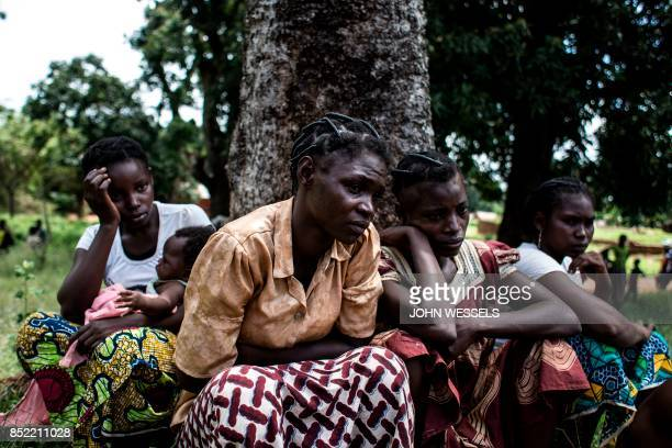 Central African women are detained for questioning in the Democratic Republic of the Congo , after fleeing the Village of Mobaye in Central African...