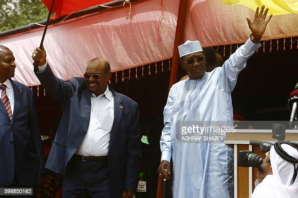 Central Africa's President Faustin Touadera Sudanese President Omar alBashir and Chadian President Idriss Deby wave on stage during a ceremony to...