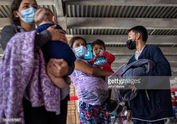 Central American asylum seekers arrive to a bus station after being released by U.S. Border Patrol agents on February 26, 2021 in Brownsville, Texas....