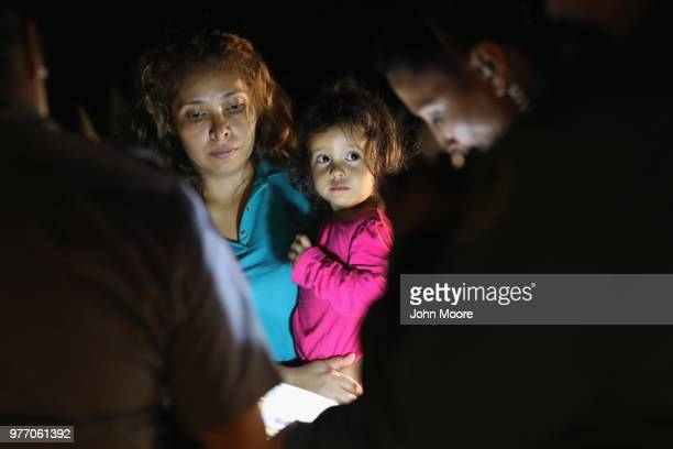 Central American asylum seekers including a Honduran girl and her mother are taken into custody near the USMexico border on June 12 2018 in McAllen...