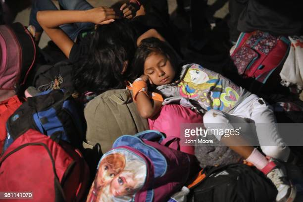 Central American asylum seekers wait for buses to take them to Tijuana on the USMexico border on April 24 2018 in Hermosillo Mexico More than 300...