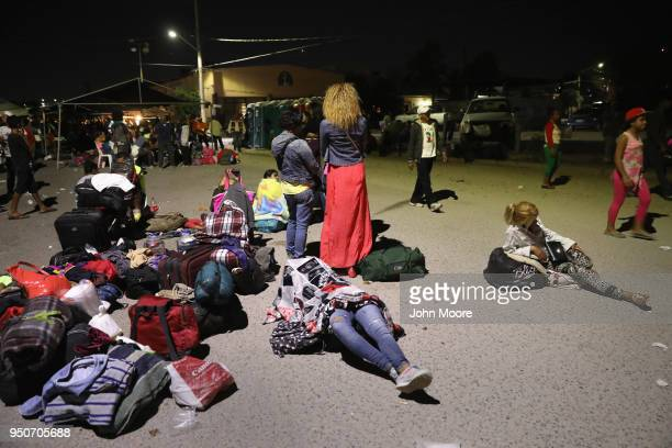 Central American asylum seekers wait for buses to take them to their next destination on thier 'caravan' north to the USMexico border on April 23...